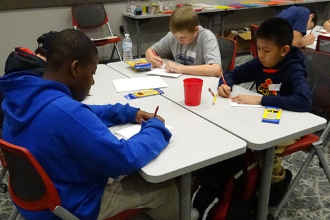 Students creating cards for a community service project